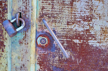 Old metal door painted gray paint with rust and cracks close up. Reklamní fotografie