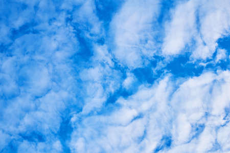 Saturated blue sky with clouds below.