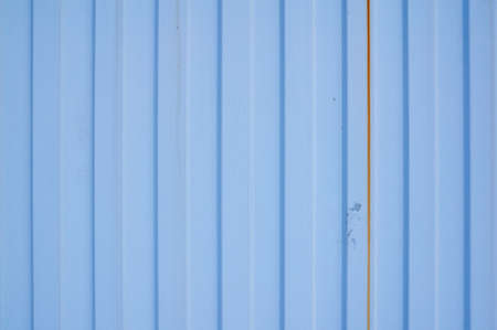 Texture of a metal fence from the profile of a blue sheet with vertical lines. Reklamní fotografie