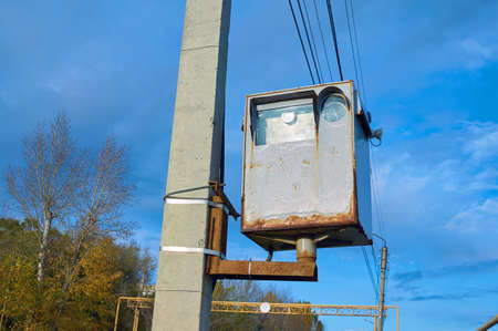 The old road rust camera surveillance for cars fixed to a concrete pillar. Reklamní fotografie