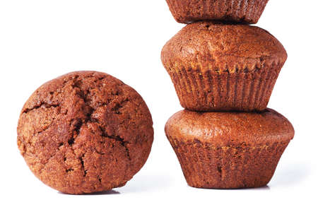 A chocolate muffin with dark test isolated on a white background.