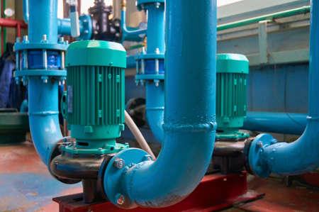 Vertical slot motors on pumps water conduit colored in blue.