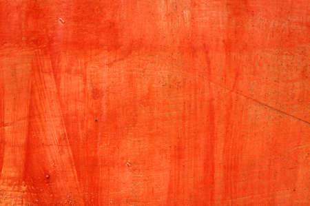Old iron background painted in red color.