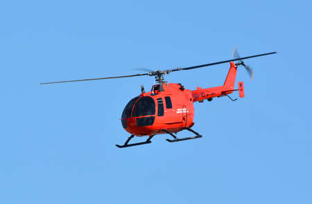 Red Helicopter in Sky Editorial