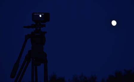 DSLR Camera on Tripod focusing the Moon