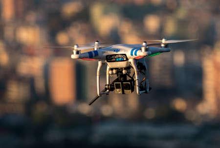 TIRANA, ALBANIA: White Drone flying over the city