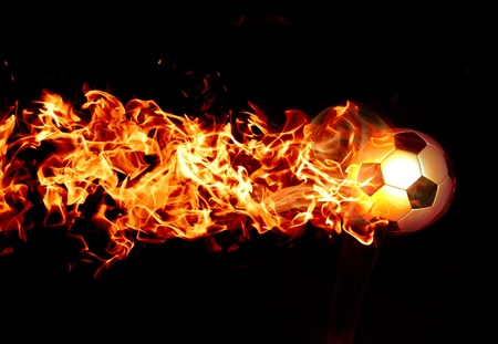 Fiery football on a black background photo