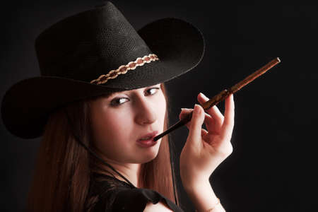 The girl in a cowboy s hat and with a mouthpiece photo
