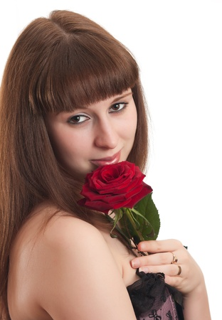 The beautiful girl with a red rose photo