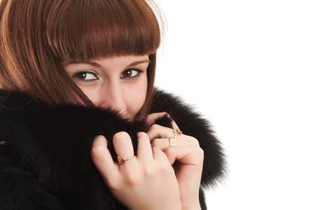 bontjas: Het meisje in een zwarte bontjas Stockfoto