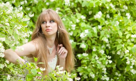 The girl looks out of bushes photo