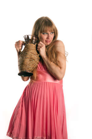 wattled: The woman in a pink dress and a wattled jug Stock Photo