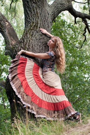 The woman of hippie and a tree photo