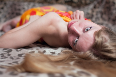 The seductive woman lies on a leopard coverlet Stock Photo - 14704679