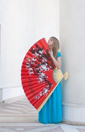 The woman presses to itself the big fan Stock Photo - 14704692