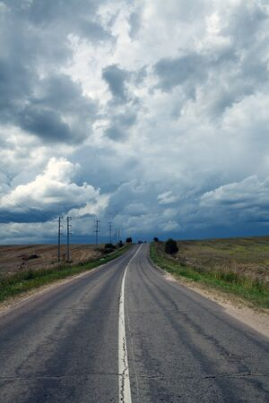 Empty road against the storm sky Stock Photo