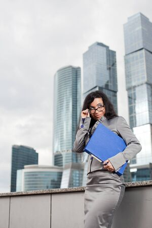 The business woman corrects spectacles Stock Photo - 15100231