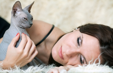The lying dark-haired woman and cat photo