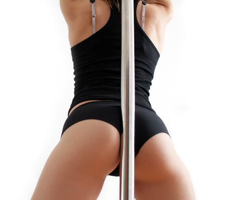 stripper pole: Back of the young woman near a pole