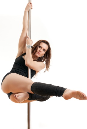 The young beautiful woman hangs on a pole Stock Photo