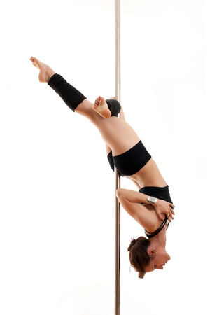 The woman keeps feet for a pole photo
