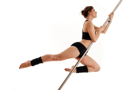 The beautiful sports woman and dancing pole photo