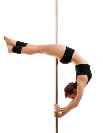 The beautiful sports woman and dancing pole Stock Photo