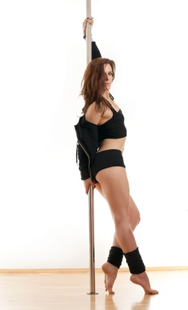 The sports woman leans the elbows on a pole photo
