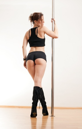 The sports young woman and dancing pole Stock Photo - 17544520