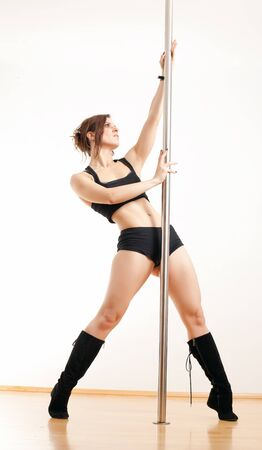 The sports young woman and dancing pole photo