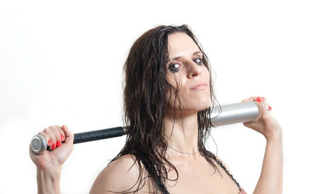 The woman the hooligan holds baseball bat Stock Photo