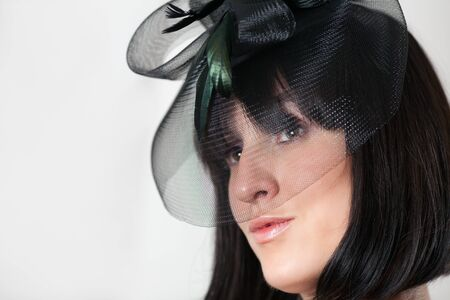 The glamour young woman in a black hat photo