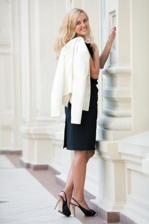 keeps: woman keeps a white jacket