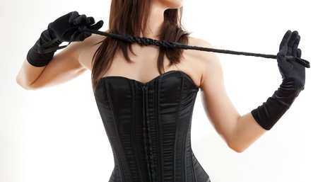 woman in a corset and a riding crop photo