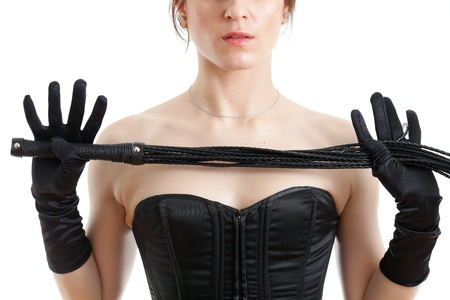 woman in black corset holds a whip photo