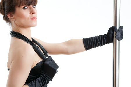 woman in black corset holds a whip Stock Photo - 18195486
