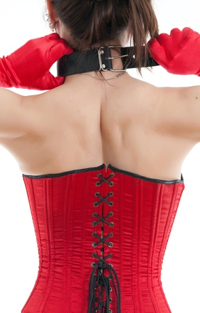 woman in a red corset with a collar around his neck photo