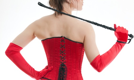 woman in a red corset and whip photo