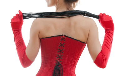 fetish wear: woman in a red corset and whip