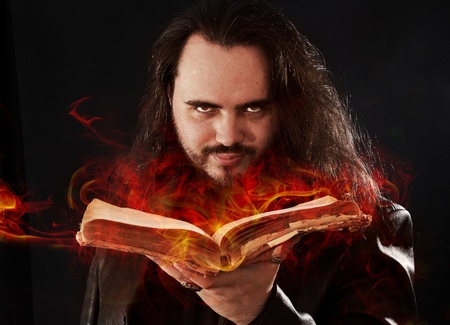 The man with burning book Stock Photo - 18764377