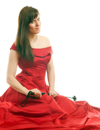 woman in a dress holding a riding crop photo