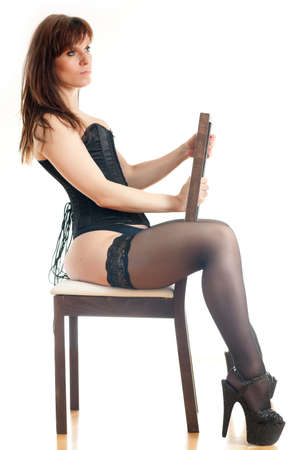 woman sitting on a chair photo