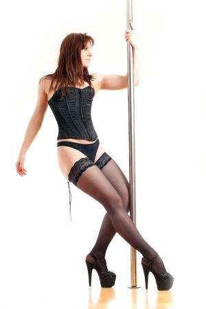 pole dancing: femme et un pole dance Banque d'images