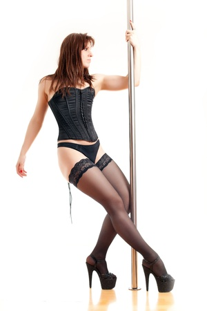 stripper pole: woman and a dance pole Stock Photo