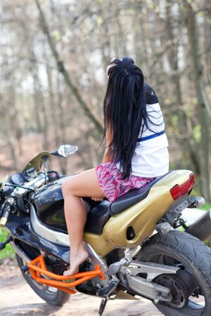 girl sitting on a motorcycle photo