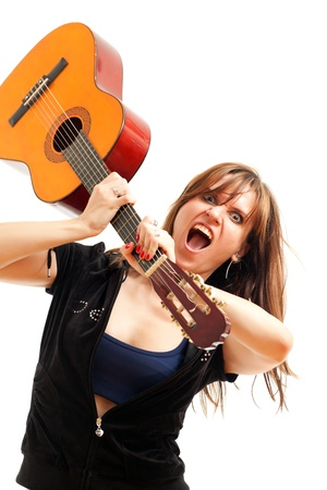 angry woman with a guitar on a white background photo