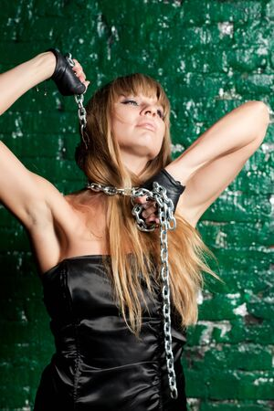 beautiful young woman with a steel chain around his neck Stock Photo - 21305121
