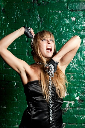 beautiful young woman with a steel chain around his neck Stock Photo - 21305122