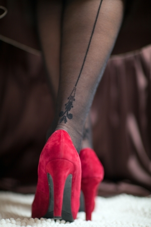 graceful female legs in red shoes with high heels closeup Stock Photo