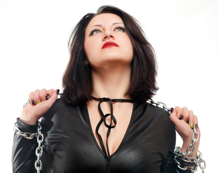 sadomasochism: seductive young girl holding a steel chain on a white background
